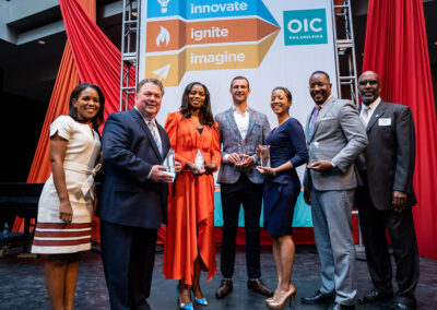 Winners holding trophies at the philadelphia OIC Luncheon 2019