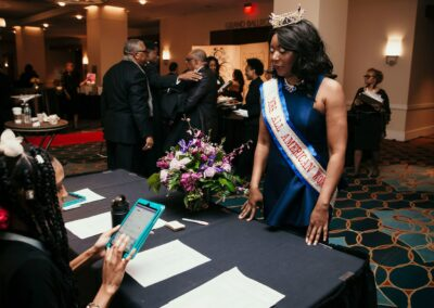 crowned and sashed queen checks in