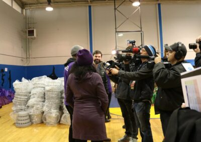 press takes video at event