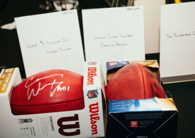 signed footballs are ready for silent auction