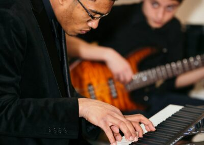 musician plays keyboard
