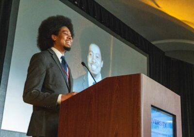 speaker speaks at podium