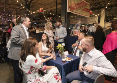 guests laugh together at event