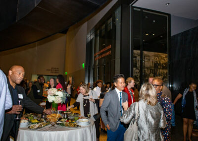 guests enjoying event at food table