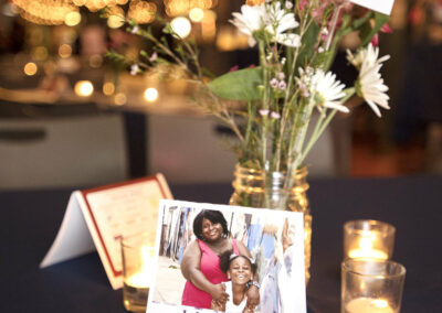 tablescape shows cards of hope and beautiful flowers