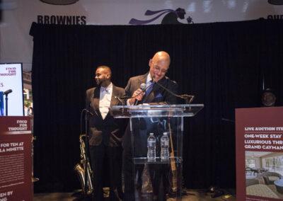 auctioneer smiles at podium