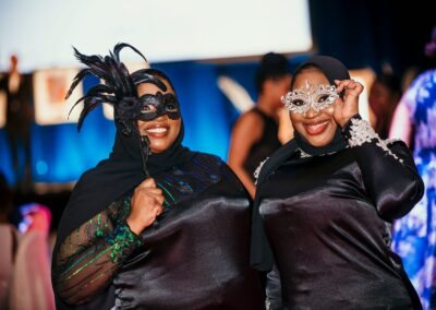 masked attendees smile and look great