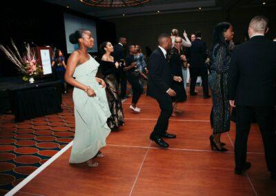 guests dance in line