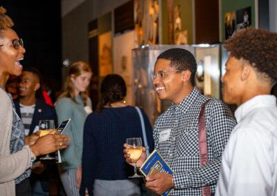 guests enjoy conference, smiling