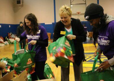 volunteers stuff bags at event