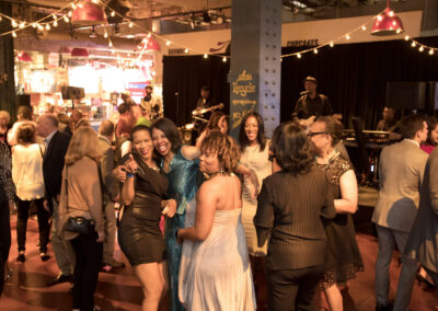 guests smile and dance at event