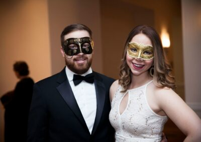 masked couple smiles