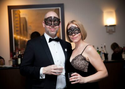 masked guests smile and look dashing