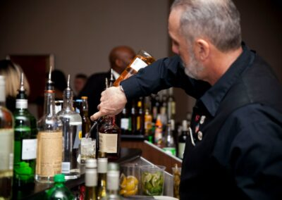 bartender pours drink at the bar