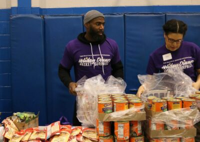 volunteer wraps cans at event