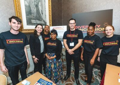 guests smile at diversity and inclusion conference in D&I t shirts