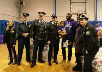 police smile with volunteers at event