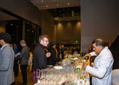 guest at bar getting champagne at event
