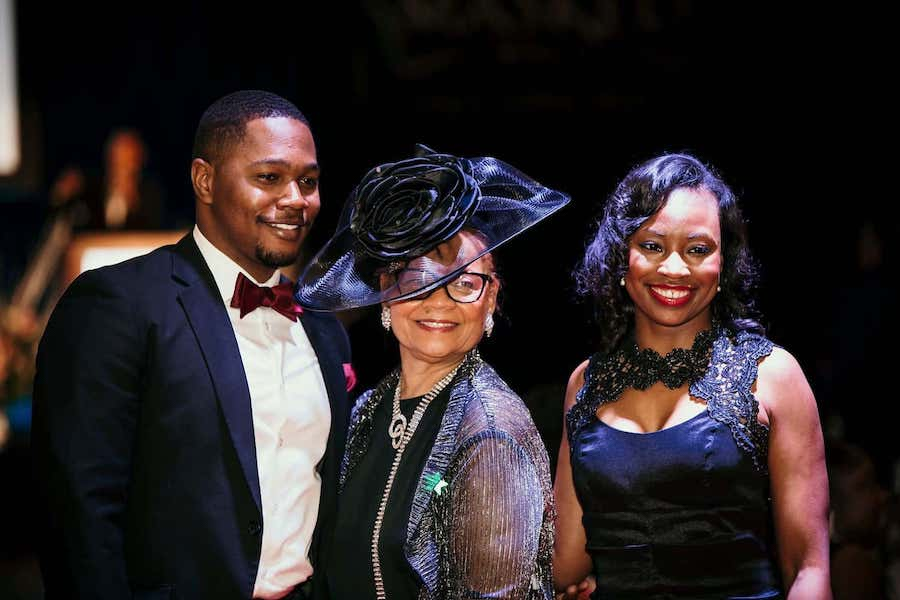 guests in fabulous elegant dress smile at masked ball